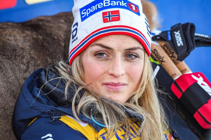 epa07188757 Winner Therese Johaug from Norway celebrate in the finish area after the Women's 10 km Interval Start Classic race of the FIS Cross Country World Cup in Ruka, Finland, 25 November 2018.  EPA/KIMMO BRANDT
