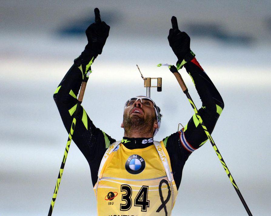 Ranskalainen Martin Fourcade juhli maailmanmestaruutta torstaina Kontiolahdella.