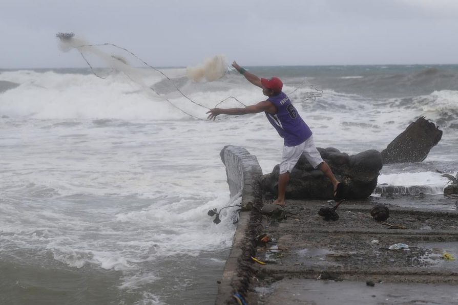 epa07018725 A Filipino fishermen fishes near the shoreline in the town of Aparri, Cagayan province, Philippines, 14 September 2018. Typhoon Mangkhut, ranked as the most powerful of the year to enter the Philippines braces for the arrival of the storm that is expected to hit the northern island of Luzon. The category 5 typhoon, Mangkhut, named Ompong in the Philippines, is moving with sustained winds of 205 km per hour (127 mph) and gusts of 255 km per hour off the eastern coast of Luzon, according to the Philippine meteorological service Philippine Atmospheric, Geophysical and Astronomical Services Administration (PAGASA).  EPA/FRANCIS R. MALASIG