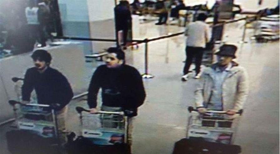 March 22, 2016 - Brussels, Belgium - Belgian police have released CCTV footage of three men suspected of carrying out the attack on a Brussels airport which left at least 14 dead and injured hundreds of others. It shows three unidentified men pushing trollies with suitcases past Zaventem airport's check-in area, two of whom are wearing a black glove on their left hand. The grainy pictures have been released by Belgian police as part of their investigation. Two of the men have dark hair, and one of them is wearing a red hat. (Credit Image: © Belgian Federal Police/Belga via ZUMA Press)