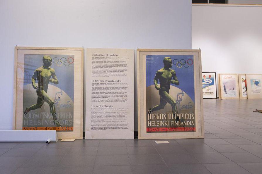 Graafikko Ilmari Sysimetsän The Flying Finn voitti vuoden 1940 pitämättä jääneiden olympialaisten julistekilpailun vuonna 1938 (juliste vasemmalla). Vuoden 1952 olympialaisia varten järjestettiin uusi julistekilpailu, mutta tilaajien mielestä ainoatakaan käyttökelpoista ehdotusta ei kilpailutöiden joukosta löytynyt. Niinpä olympialaisten järjestelytoimikunta ilmoitti käyttävänsä Sysimetsän edellisen kilpailun voittanutta Paavo Nurmi -julistetta. Ei tarvinnut kuin vaihtaa päivämäärä  ja muokata taustalla maapallossa näkyvän Suomi-neidon muotoja: poistettiin toinen käsivarsi ja kavennettiin Karjalaa.