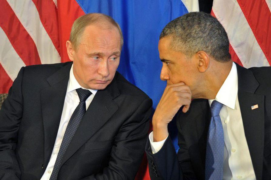 Presidentit Vladimir Putin ja Barack Obama. Putinin valtakausi jatkuu, Obama luovuttaa kohta vallan Donald Trumpille. Arkistokuva.
